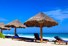 Beach chairs on exotic tropical sand beach Stock Photography