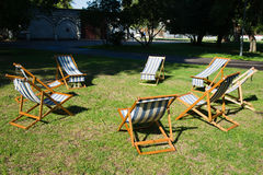 Beach chairs on the grass are waiting for a brainstorming work. Or some other team work or rest Stock Photo