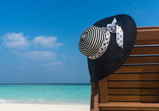 Beach chairs with hat on white sandy beach Royalty Free Stock Photos