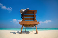 Beach chairs with hat on white sandy beach Stock Photography