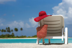 Beach chairs with hat on white sandy beach. Royalty Free Stock Photos