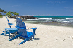 Beach Chairs Hawaii. Two empty blue Anirondack style chairs sit on a Hawaiian beach facing the Pacific ocean royalty free stock photography