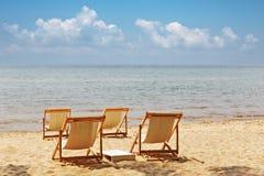 Beach chairs on idyllic tropical beach. Stock Photo