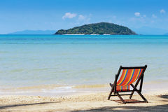 Beach chairs on idyllic tropical beach. Stock Images