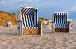 Beach chairs - Kampen, Sylt. Sunset and beach chairs - Kampen, Sylt Stock Images
