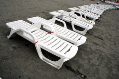 Beach chairs in line Royalty Free Stock Photography