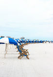 Beach Chairs. A line of chairs is set up every morning on the beach for rent by tourists royalty free stock image