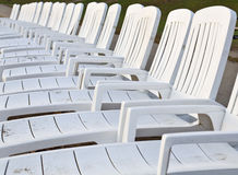 Beach chairs lined up at a beach Stock Image