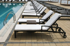 Beach chairs lined up in a row Royalty Free Stock Photo