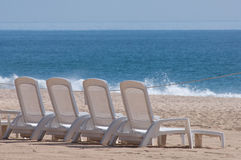 Beach chairs. Lined up waiting for the afternoon sun Royalty Free Stock Photos