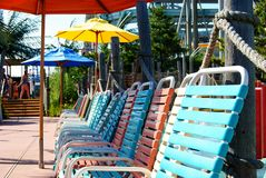 Beach Chairs. Lined up waiting for visitors Stock Photo