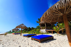 Beach chairs in luxury resort on carribean coast Stock Photo