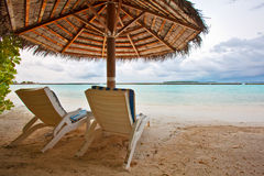 Beach chairs in Maldives. The beach chairs for couple to enjoy the sunshine in Full Moon island of Maldives Royalty Free Stock Photo
