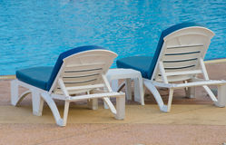 Beach chairs near swimming pool Royalty Free Stock Photos