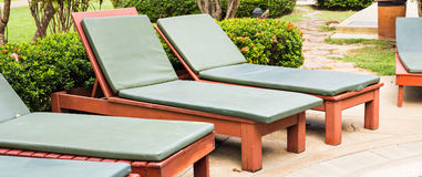 Beach chairs near swimming pool Stock Photography
