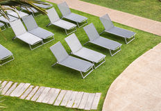 Beach chairs near swimming pool Royalty Free Stock Photo