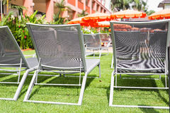 Beach chairs near swimming pool Stock Photo