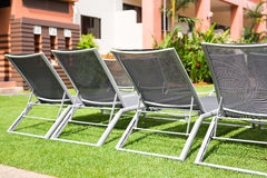 Beach chairs near swimming pool Stock Image