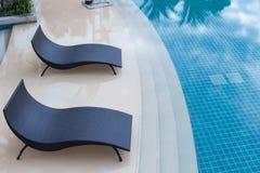 Beach chairs near swimming pool, top view. Beach chairs near swimming pool,  top view Royalty Free Stock Image