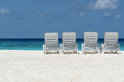 beach chairs by the ocean Royalty Free Stock Photos