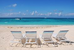 Beach chairs at ocean front Stock Photos