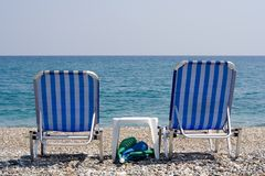 Beach-Chairs Overlooking the Ocean. A pair of beach-chairs just by the sea stock image