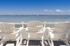 Beach chairs overlooking ocean Stock Photography