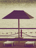 Beach Chairs and Parasol Stock Photography