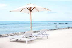 Beach chairs and Parasol on exotic tropical white sandy Royalty Free Stock Images
