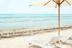 Beach chairs and Parasol on exotic tropical white sandy Stock Image