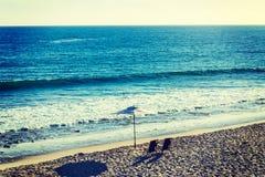 Beach chairs and parasol in Malibu. California Royalty Free Stock Photo