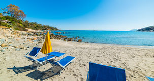 Beach chairs and parasol in Porto Frailis Royalty Free Stock Images