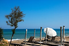 Beach chairs and a parasol Royalty Free Stock Photo