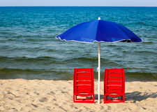 Beach chairs with parasol Stock Images
