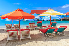 Beach chairs and parasols in tropical paradise Stock Photo