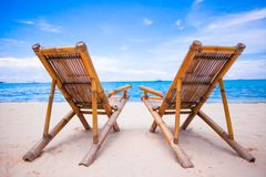 Beach chairs on perfect tropical white sand beach Royalty Free Stock Photography