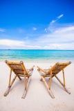 Beach chairs on perfect tropical white sand beach Stock Photo