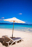 Beach chairs on perfect tropical white sand beach Stock Photos