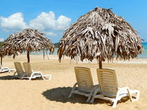 Beach chairs on perfect tropical white sand beach Stock Photography