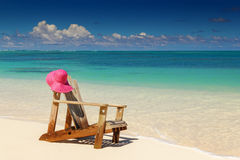 Beach chairs with pink hat  on white sand Royalty Free Stock Photo