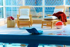 Beach chairs by the pool Royalty Free Stock Photos
