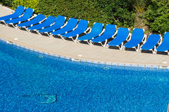 Beach chairs by the pool Stock Image
