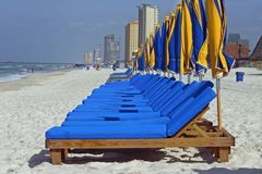 Beach Chairs at the Ready. A row of bright colored beach chairs and umbrellas ready for lounging Stock Images