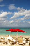 Beach chairs and red umbrella royalty free stock photo