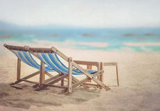 Beach chairs. Chairs for relaxing on the beach (retro filter Stock Images