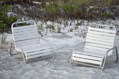 Beach chairs on sand Royalty Free Stock Photography