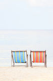 Beach chairs on sand beach Stock Image
