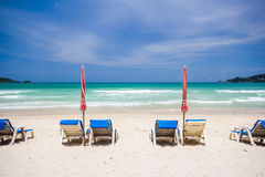Beach chairs on sand beach Royalty Free Stock Photos