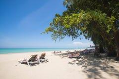 Beach chairs on the sand beach Stock Photography