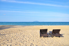 Beach chairs on sand beach. Concept for rest, relaxation, holida Stock Photos